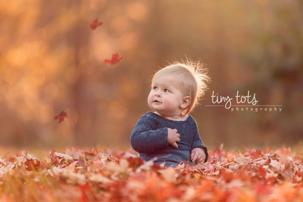 baby-girl-watching-leaves-fall