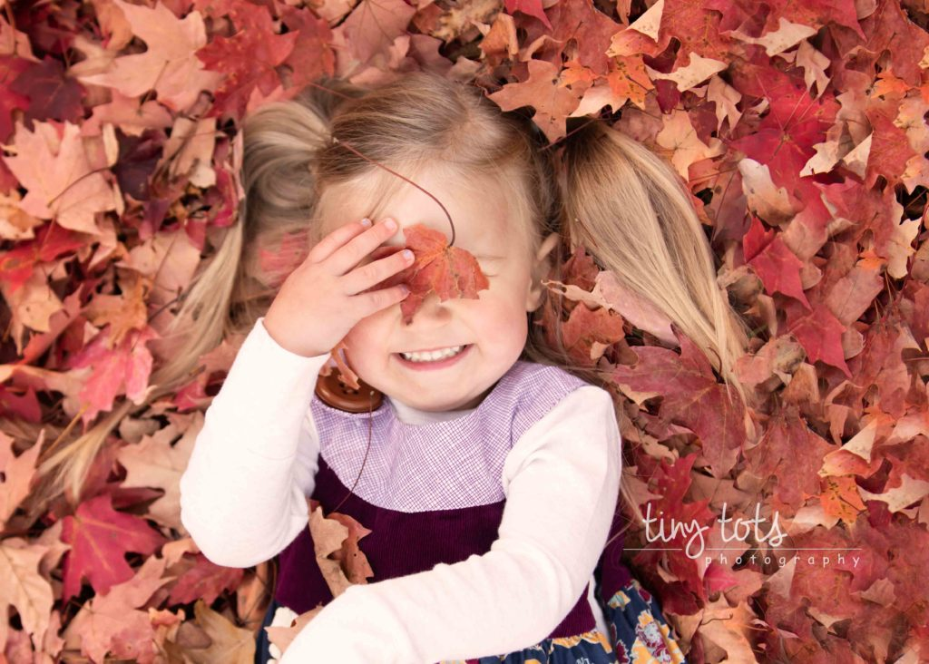 toddler-girl-playing-fall-leaves